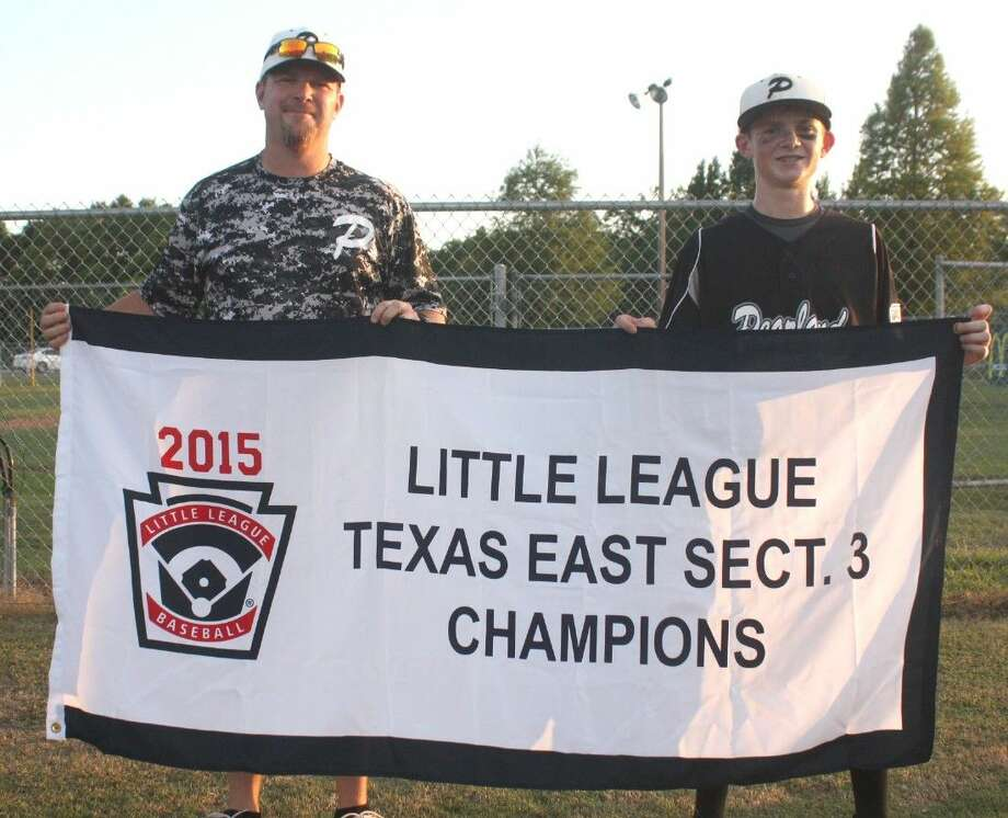 Former standout Deer Park High School baseball player Jeremy Tadlock and his son, Jarrett, hold the Section 3 championship banner Pearland West captured last month en route to their berth to the Little League World Series that starts Thursday afternoon. Tadlock, the 1994 co-MVP of the district race, thanks to a .457 batting average, is Pearland West's hitting coach. Photo: Robert Avery