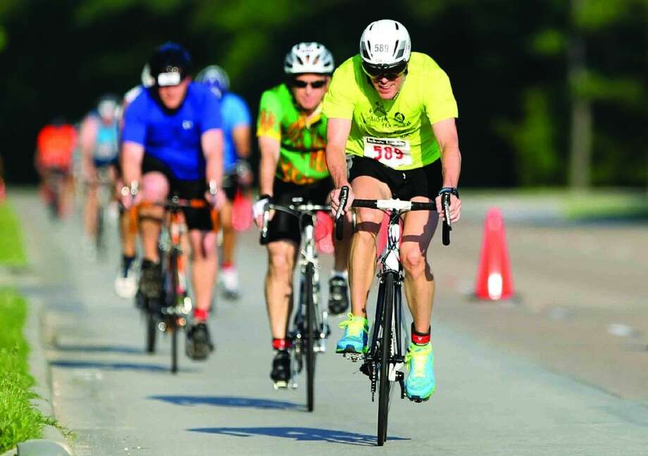 Triathletes compete in the cycling portion of the CB&I Triathlon May 2 in The Woodlands. More than 1,400 registered in this year's event, scheduled for Saturday at Northshore Park. Photo: Jason Fochtman