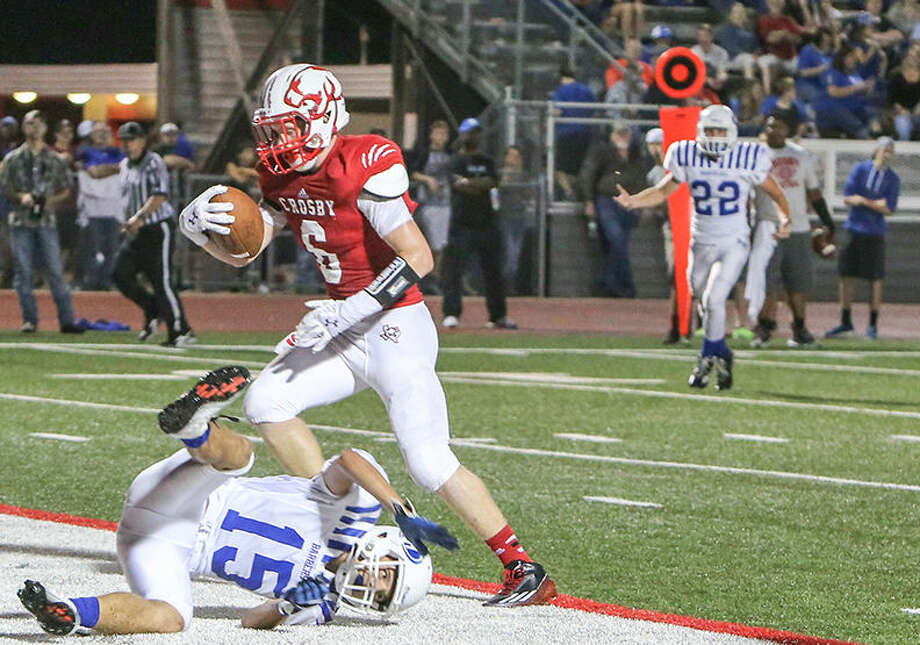 Crosby's Trevor Larkin scores a touchdown against Barbers Hill in a District 21-5A game in Crosby on Friday. Photo: Linda Sims / Texas Sports Photog