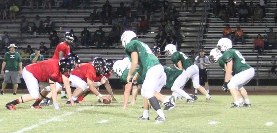 The Livingston Lions (right) prepare for a another assault from the Coldspring-Oakhurst Trojans. Photo: Jacob McAdams