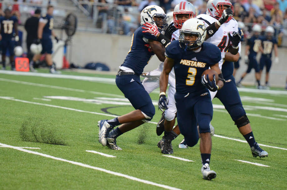 Joseph Johnson and Cy Ranch defeated Cy Lakes, 31-2 Friday night at the Berry Center. Photo: Joel Weckerly/CFISD
