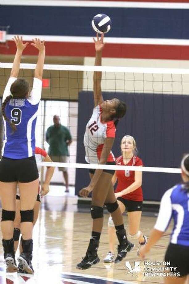 Cy Lakes senior middle Tomar Thomas had 22 kills in the win over Cy Woods on Friday.