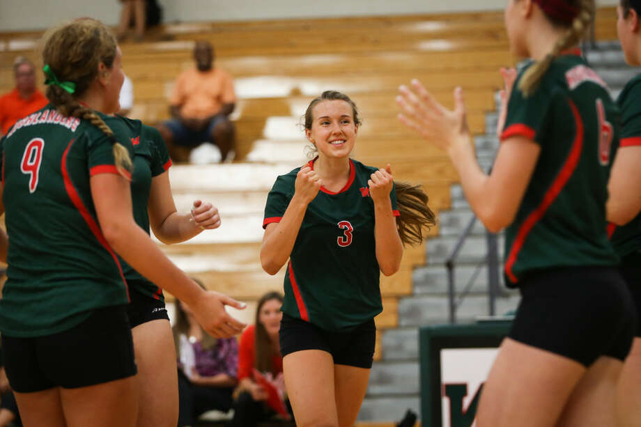The Woodlands' Hailey Reier (3) celebrates with teammates during the high school volleyball game against Seven Lakes on Tuesday, Aug. 18, 2015, at The Woodlands High School. To view more photos from the game, go to HCNPics.com. Photo: Michael Minasi