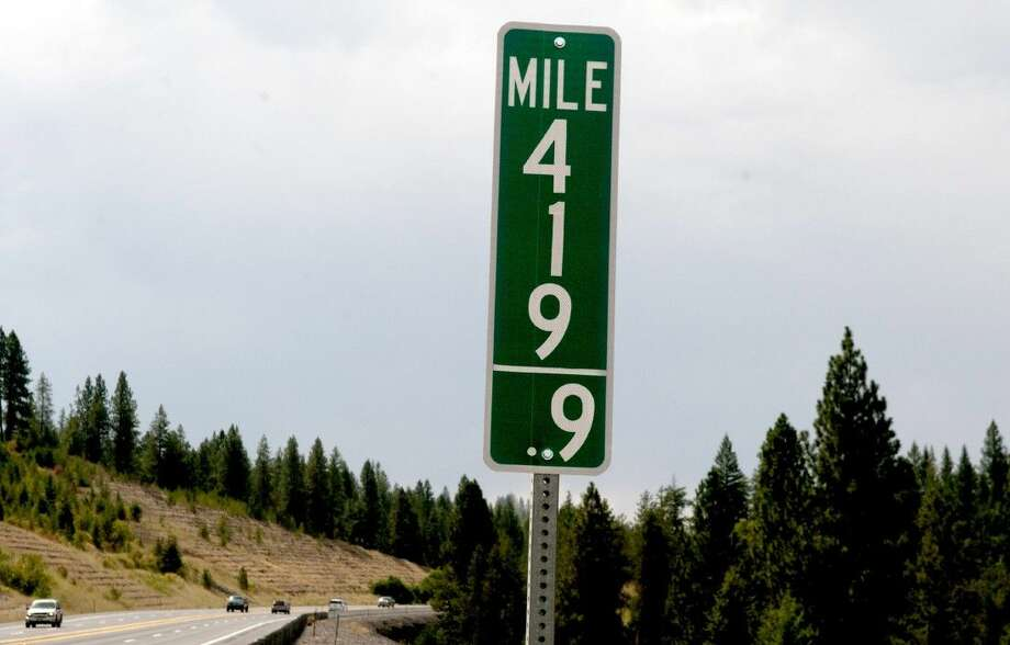 In this Tuesday, Aug. 11, 2015 photo, vehicles pass a 419.9 milepost just south of Coeur d'Alene, Idaho.