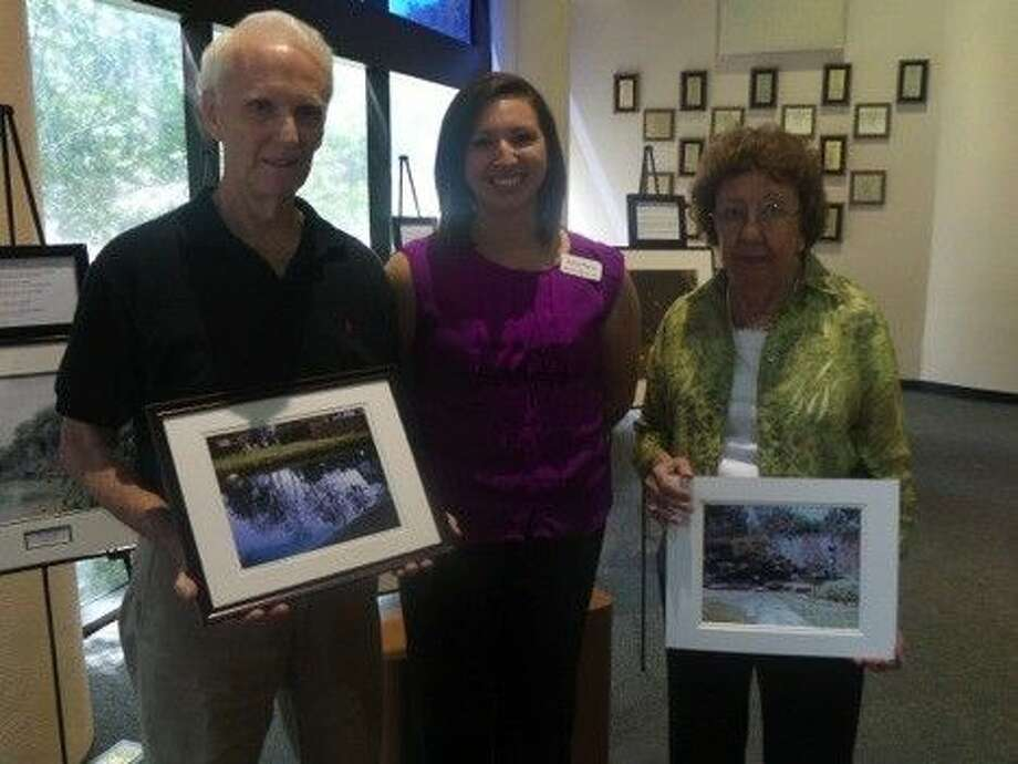 SubmittedAlzheimer's Association patients Tony Hughes, left, and Ellen Box, right, pose with Marisa Ramón, a Regional Outreach Coordinator with the Alzheimer's Association, and pose with their own photographs.