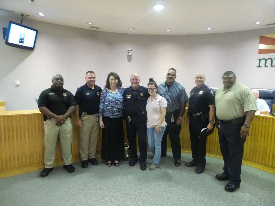 SubmittedFamily members and Missouri City Police Department Command Staff stand with Missouri City's new Assistant Chief of Police Lance Bothell, center.