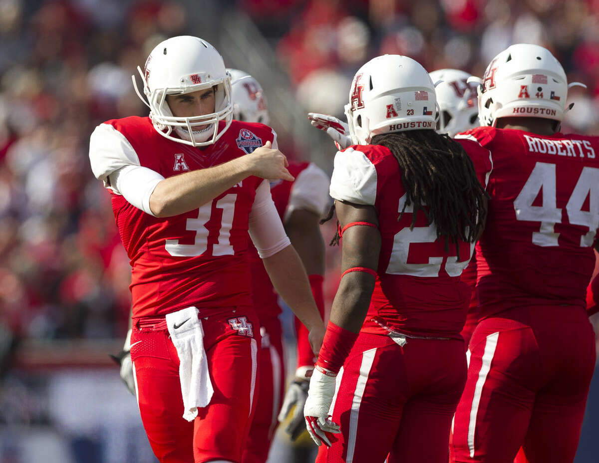 Punter Logan Piper, of Houston, celebrates after a kick during the American Athletic Conference championship game Dec. 5 at TDECU Stadium in Houston. The Cougars were selected to play Florida State in the Peach Bowl.