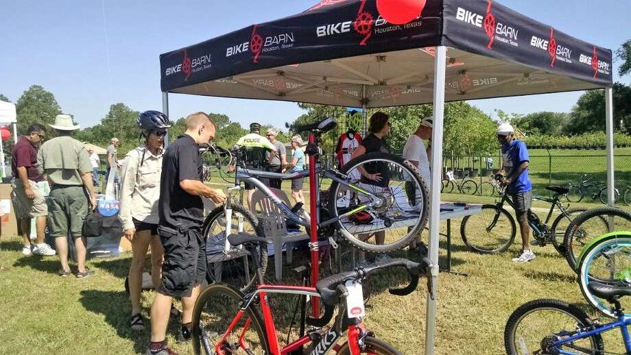Many of the hundreds of visitors to Earth Day at Exploration Green arrived on their bicycles. Bike Barn was on hand to do a quick tune-up, answer questions and showcase some of their specialty bikes.