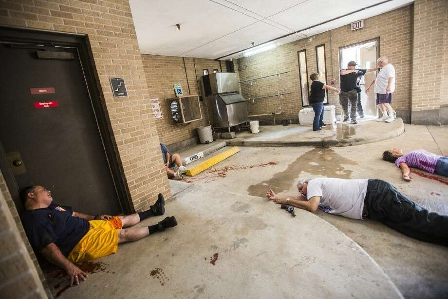 Officers enter a mass casualty incident during a training session for potential SWAT members Aug. 18, 2015, at the Humble Police Department. Photo: ANDREW BUCKLEY