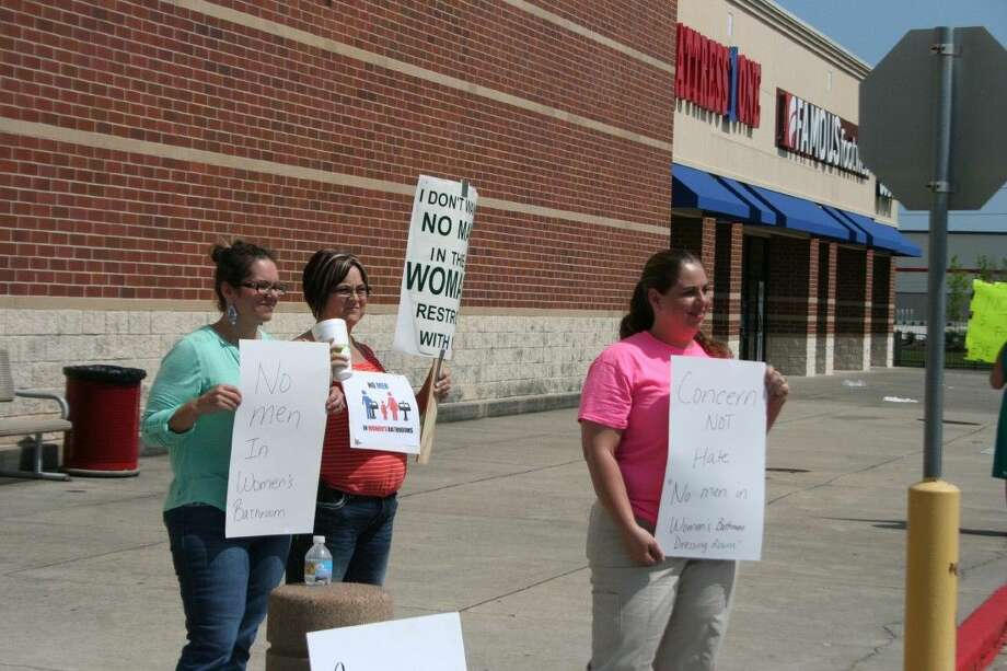 Residents against Target's transgender bathroom policy hold signs outside of the Target store in Humble Wednesday, April 27, 2016.