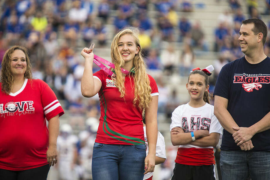 Kelsey Brann shows off her bronze medal from the 2014 Youth Olympics as she is honored during Atascocita's 14-10 victory over Klein on Sept. 13, 2014, at Turner Stadium in Humble. Photo: ANDREW BUCKLEY