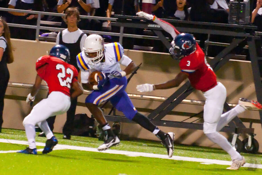 Jersey Village's Rokeem Paul catches the winning touchdown against Cy Springs on Saturday at Pridgeon Stadium. Photo: Tony Gaines/HCN