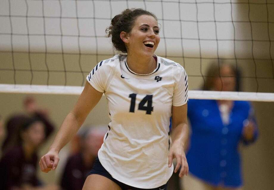 College Park's Allicia Bauerseld smiles after scoring a point during a high school volleyball match against Cy-Fair Tuesday. To view or purchase this photo and others like it, visit HCNpics.com.