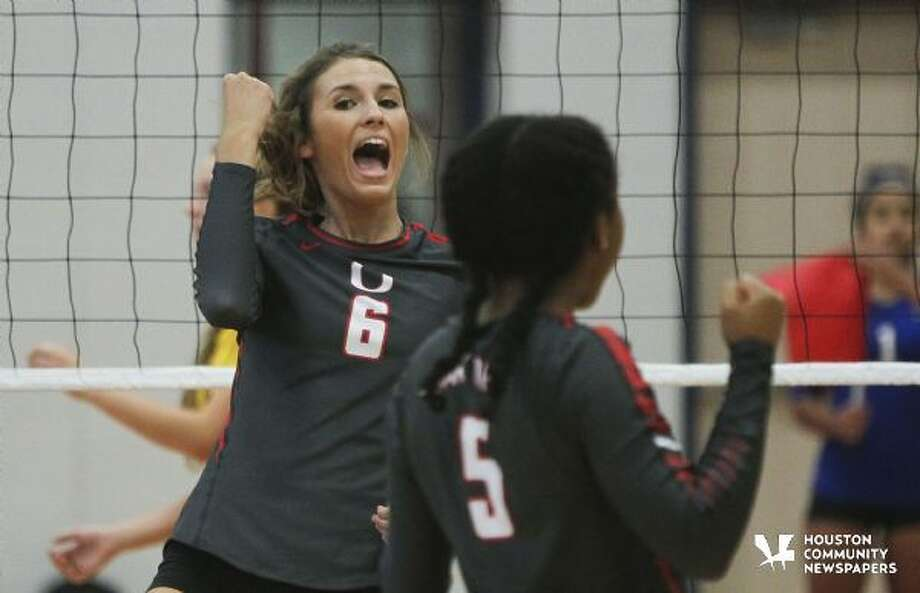 Oak Ridge's Molly Russell celebrates after scoring a point in the first set against Montgomery during a high school volleyball game last Tuesday. More photos at HCNpics.com Photo: Jason Fochtman
