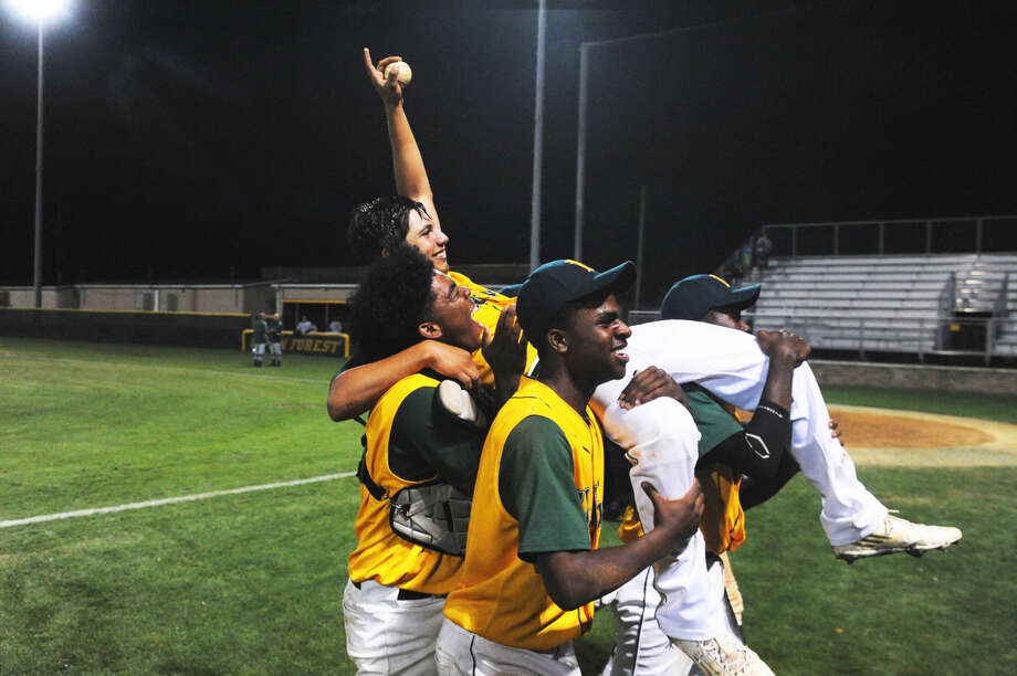 The Klein Forest Golden Eagles celebrate senior right fielder Niko Palacios' walk-off single Wednesday, April 27, 2016. The 5-4 victory keeps Klein Forest's playoff hopes alive, pending Thursday's game between Klein Oak and Montgomery. Photo: Tony Gaines