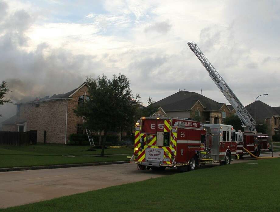 A ladder truck and three fire engines were dispatched by the Pearland Fire Department to a burning home in the Lakes of Savannah subdivision just southwest of Pearland Sunday (April 24) evening. Photo: Kristi Nix