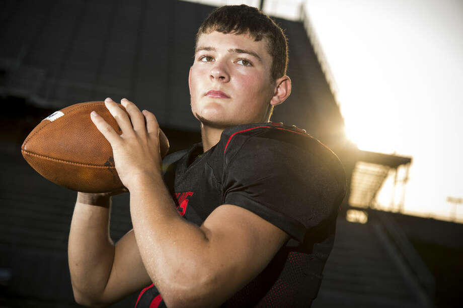 Spartans quarterback Jake Hall (11) poses for a portrait Aug. 13, 2015, at Texan Drive Stadium in New Caney. Photo: ANDREW BUCKLEY