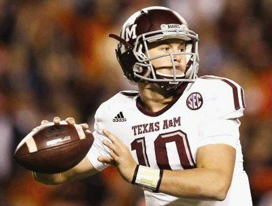 Texas A&M quarterback Kyle Allen sets back to throw against Auburn last season.