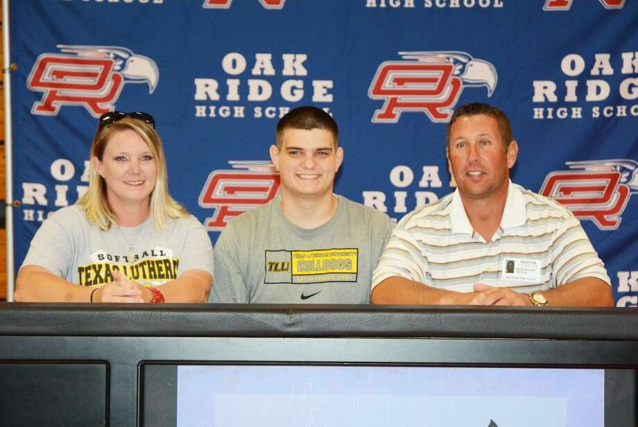 Oak Ridge's Caleb Bussell poses with his family after signing his National Letter of Intent to play football at Texas Lutheran University.