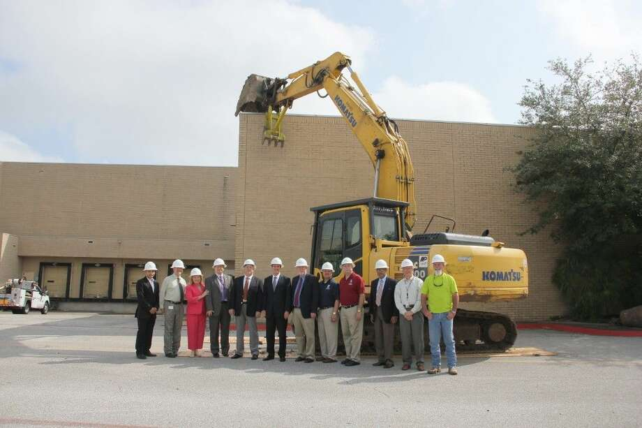 Fidelis Realty Partners, owner of San Jacinto Mall, kicked-off the initial demolition phase of the mall's redevelopment project Thursday, April 28, 2016, at 10 am outside the former Ward's and Bealls buildings. In attendance at the event were officials from the City of Baytown, including Mayor Stephen DonCarlos and Fidelis CEO Alan Hassenflu. Pictured (L-R) Hector Mendez, Interim Director, Development, Construction, & Facilities Management (Fidelis Realty Partners); Kevin Troller, Assistant City Manager (CoB); Mary Evans, General Manager, San Jacinto Mall (Fidelis); Rick Davis, City Manager (CoB); Bill Patin, Associate Principal, Boucher Design Group; Alan Hassenflu, CEO (Fidelis); Stephen DonCarlos, Mayor (CoB); Brandon Capetillo, Councilman, District 3 (CoB); Terry Sain, Councilman, District 4 (CoB); B.J. Simon, Associate Executive Director, Economic Development Foundation; Ron Bottoms, Deputy City Manager (CoB); and Dennis Clooney, Demolition Experts. Photo: Submitted