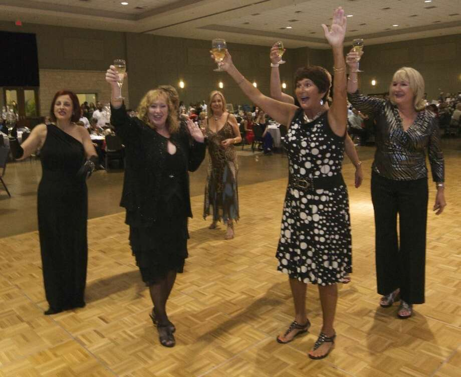 """Courtesy photoLady Lions from the Conroe Noon Lions Club toast the audience during the annual """"Legend of the Lion"""" - Dinner/Dance & Auction last Thursday night at the Lone Star Convention Center."""