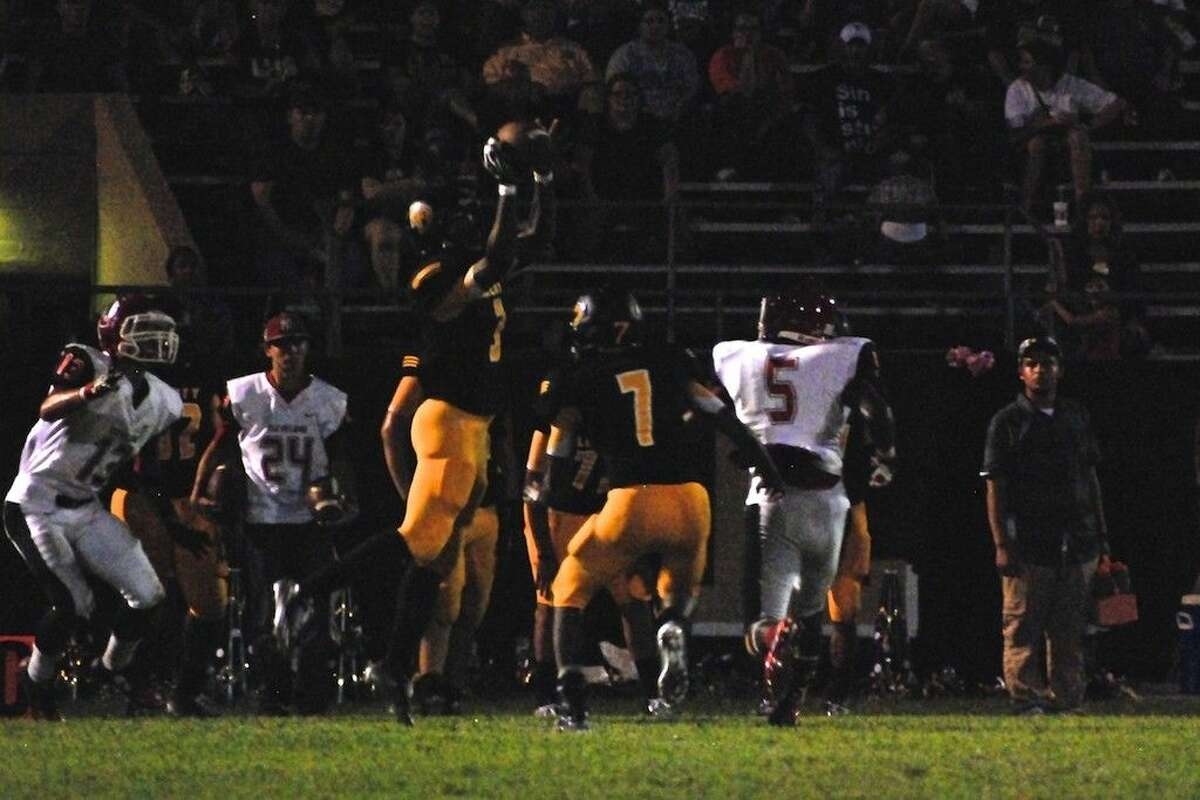 Staff photo by Casey StinnettLiberty's Trey Antoine intercepts a Cleveland pass in the second quarter, Sept. 12.