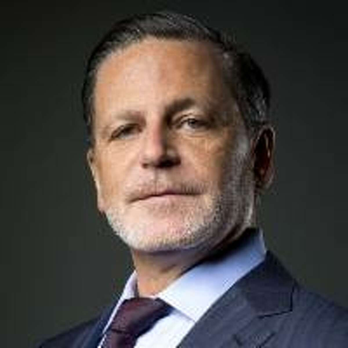 Daniel Gilbert, cofounder of Quicken Loans, is worth an estimated $30.9 billion and was ranked 23 on Forbes' list of 2021 billionaires. Gilbert and his companies have invested $5.6 billion to purchase and rehab a swath of buildings in downtown Detroit, with a plan to create 24,000 jobs, according to Forbes.