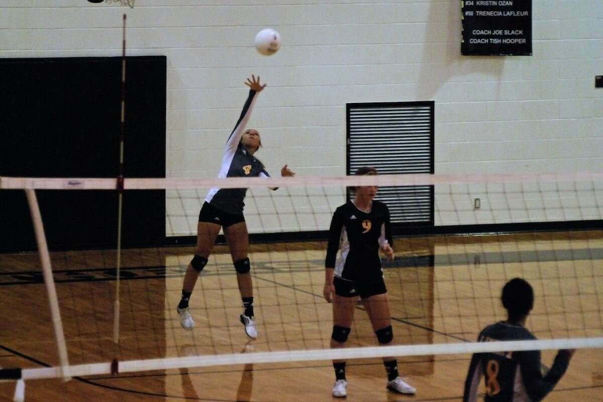 Staff photo by Casey StinnettMarissa Goudeau serves for Liberty in the 3-0 victory over visiting MacArthur on Friday, Sept. 12.