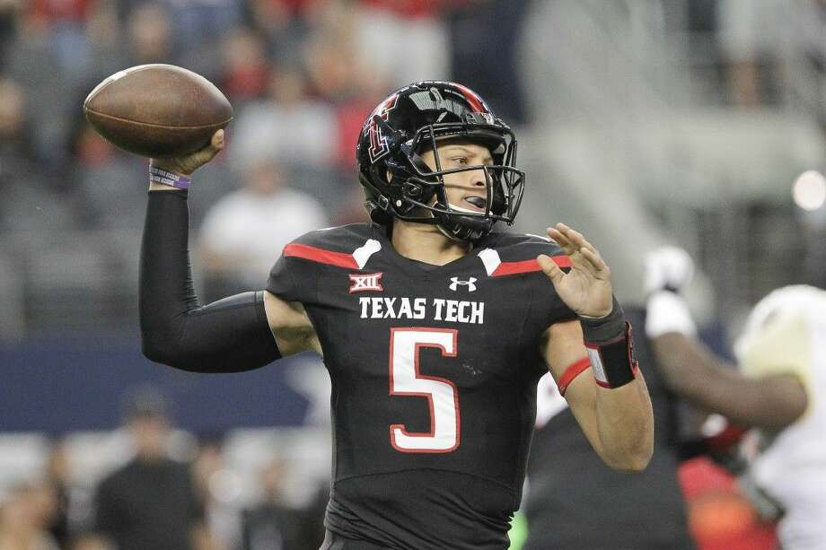 Texas Tech quarterback Patrick Mahomes throws a pass during the first half of an NCAA college football game against in Arlington.