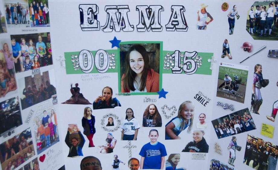 Friends of Emma Ivanovsky put together a collage in her honor for her vigil at the South Montgomery Girls Softball League Field Wednesday. Go to HCNpics.com to view more photos from the vigil. Photo: Jason Fochtman