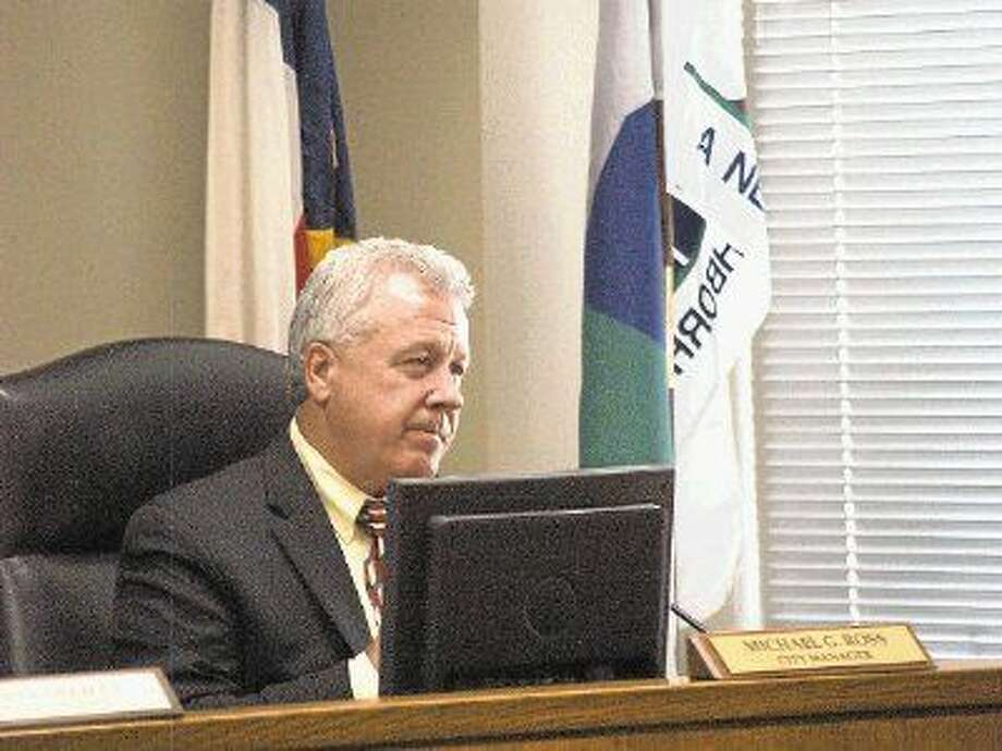 Michael Ross hears public comments in support of keeping him as City Manager at the West University City Council meeting on Monday, Aug. 10. Ross was dismissed as City Manager.