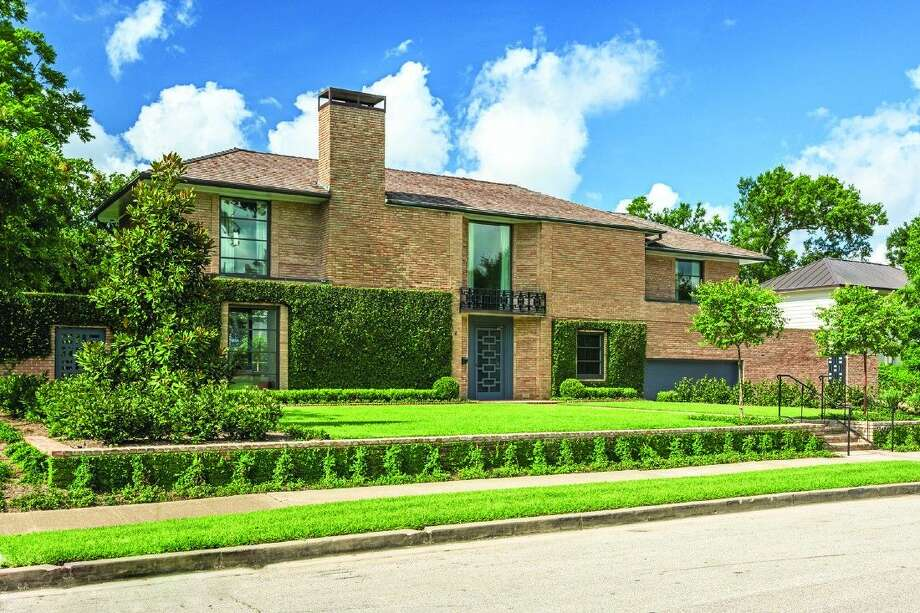 This unique John Staub-designed family home at 3405 Meadow Lake Lane in River Oaks is among the five historic private residences that will be open to visitors on Saturday, April 30 and Sunday, May 1 during Preservation Houston's Good Brick Tour Photo: Peter Molick Photography