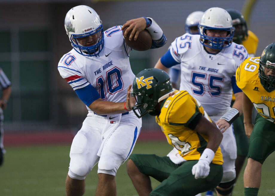 Oak Ridge's Braden Letney (10) attempts to break the tackle of a Klein Forest defender on Friday, September 12, 2014, at Klein Memorial Stadium in Klein, Tx. (For HCN - Conroe Courier / Joe Buvid) Photo: Joe Buvid