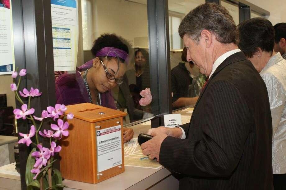 Harris County Judge Ed Emmett recently renewed his passport at the Harris County District Clerk's passport service.
