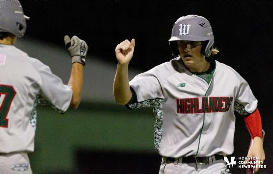 The Woodlands' Evan Samoff, right, gets a fist bump from Clay Creighton after scoring a run earlier this year. Photo: Jason Fochtman