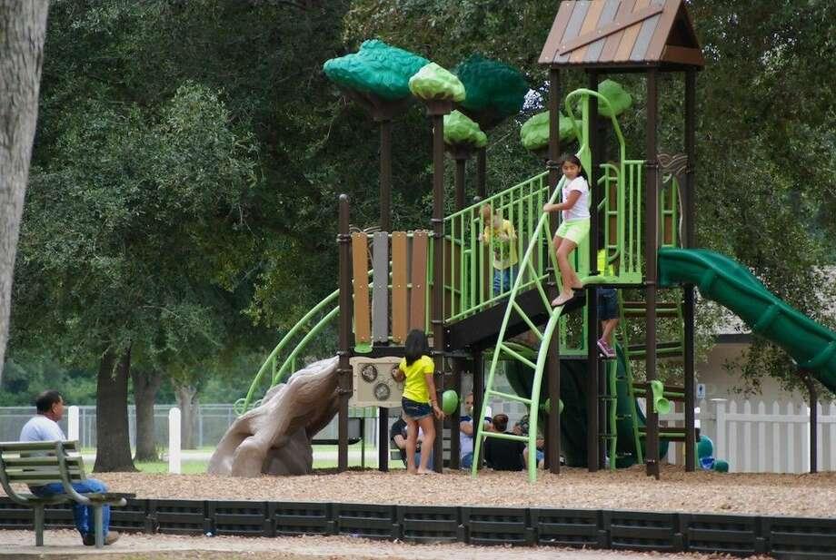 Staff photo by Casey StinnettKids enjoy the new playground set put up at the Liberty Municipal Park. Photo: Casey Stinnett