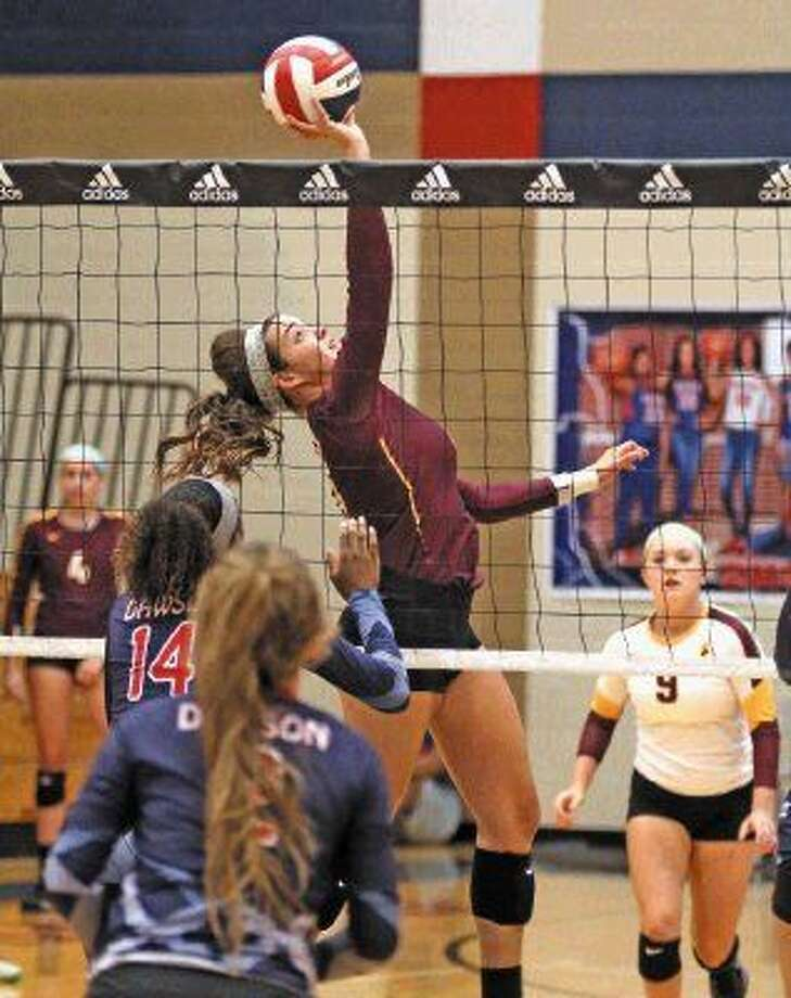 Deer Park's Kiley Smith (13) goes up high for the ball against Dawson at the Adidas Invitational.