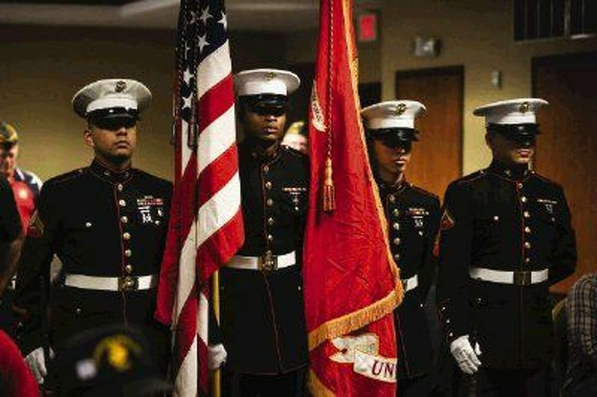 Staff photo by Michael MinasiMembers of the Marine Corps present the colors before the memorial service for the WWII veterans of the Marine Corps Forgotten Battalion on Saturday, Sept. 13, 2014, at the Hilton Garden Inn in The Woodlands.