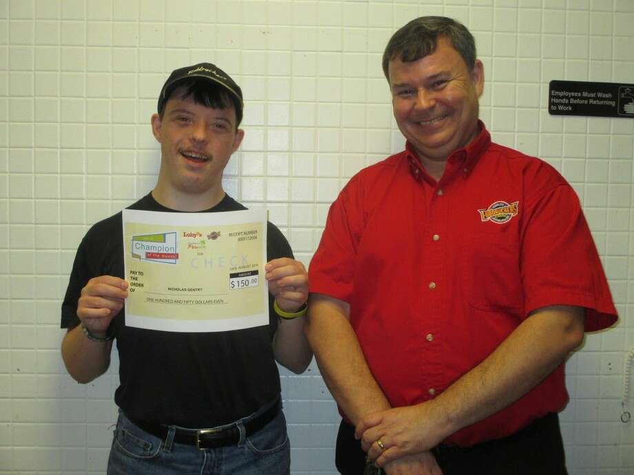 SubmittedNick Gentry, a guest service ambassador at Fuddruckers in Kingwood, was named Champion of the Month for August.
