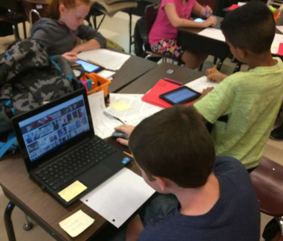 At Piney Woods Elementary, 50+ fourth graders are using all the technology hardware they can find to work on research projects.