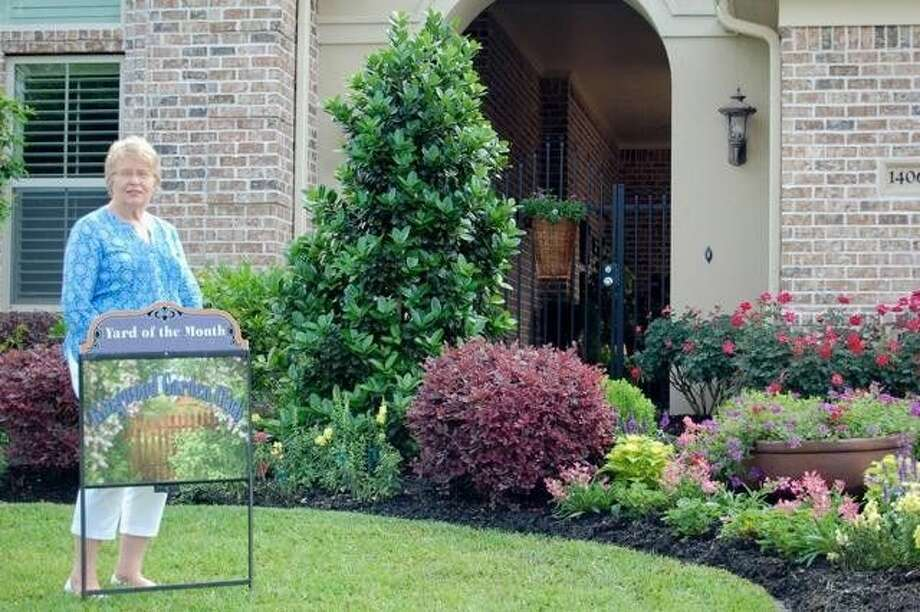 The beautiful lakefront home of Ann and Don Hartman is the Kingwood Garden Club's May Yard of the Month.