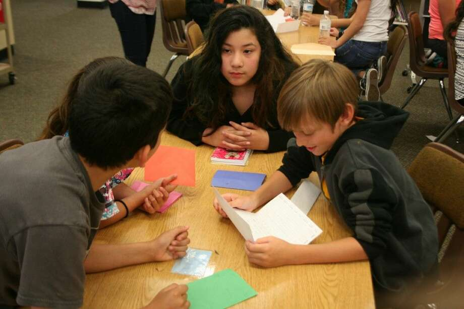 Oaks Elementary fourth graders read letters from their Pen Pals during their annual lunch with their pen pals who are Vita-Living clients on Thursday, April 28, 2016.