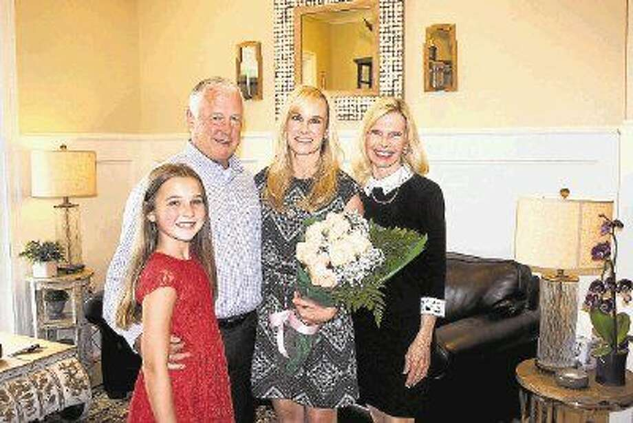 """Allyson """"Ally"""" Seder (center) has been named one of this year's Hometown Heroes. Pictured with Seder are daughter, Maddie, husband, Mike, and Interfaith of the Woodlands President and CEO Dr. Ann Snyder."""