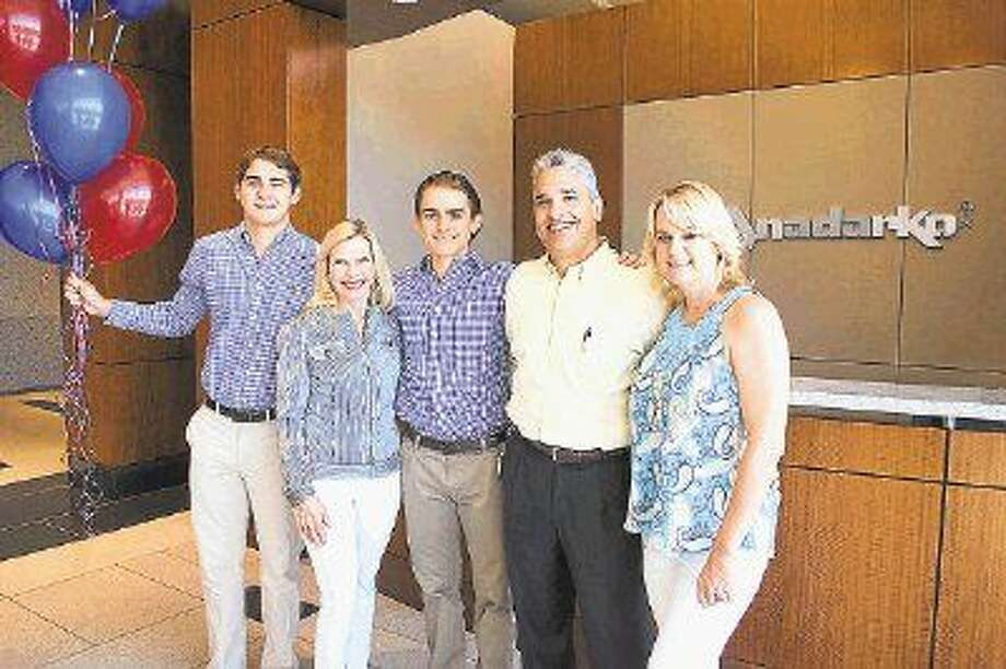 Mario M. Coll, III (second from right) has been named a 2015 Hometown Hero. Pictured with Coll are sons, Jake and Joey, wife, Sarah and President and CEO of Interfaith of The Woodlands Dr. Ann Snyder (second from left).