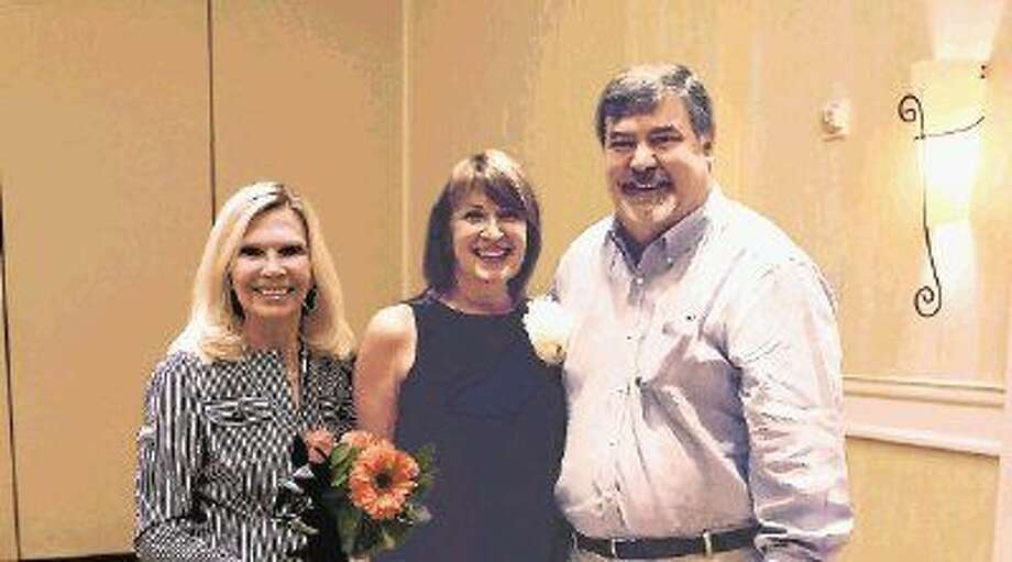 President and CEO of Interfaith of The Woodlands Dr. Ann Snyder (left), congratulates Lisa Koetting (center) for being named a 2015 Hometown Hero. Pictured with Koetting is her husband, Fred.