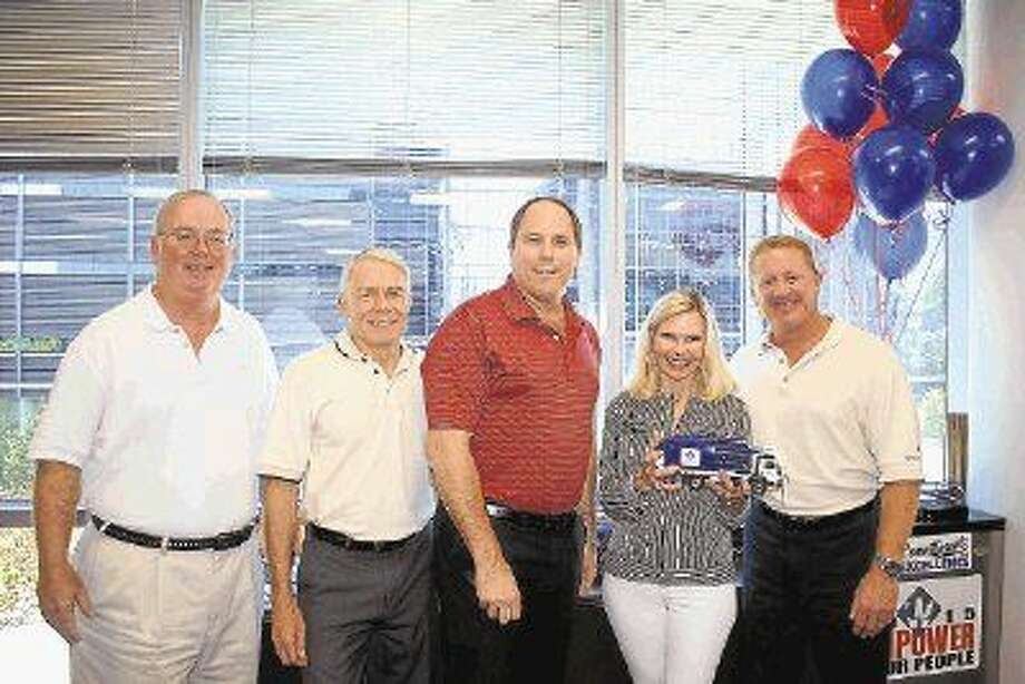 Waste Connections, Inc. has been named a 2015 Hometown Hero. Pictured are Executive Vice President and Chief Financial Officer Worthing Jackman, President Steve Bouck, Senior Vice President, Sales and Marketing David Hall and Chairman and CEO Ron Mittelstaedt with President and CEO of Interfaith of The Woodlands Dr. Ann Snyder.