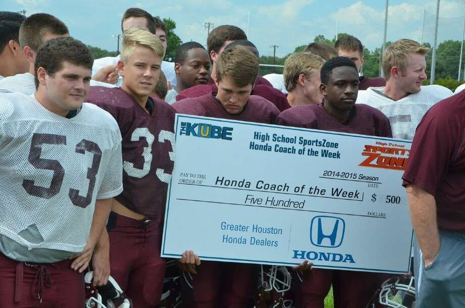 Submitted PhotoBobcat football players display the $500 check donated by the Greater Houston Honda Dealers to the Cy-Fair Athletic Booster Club. Photo: Submitted Photo