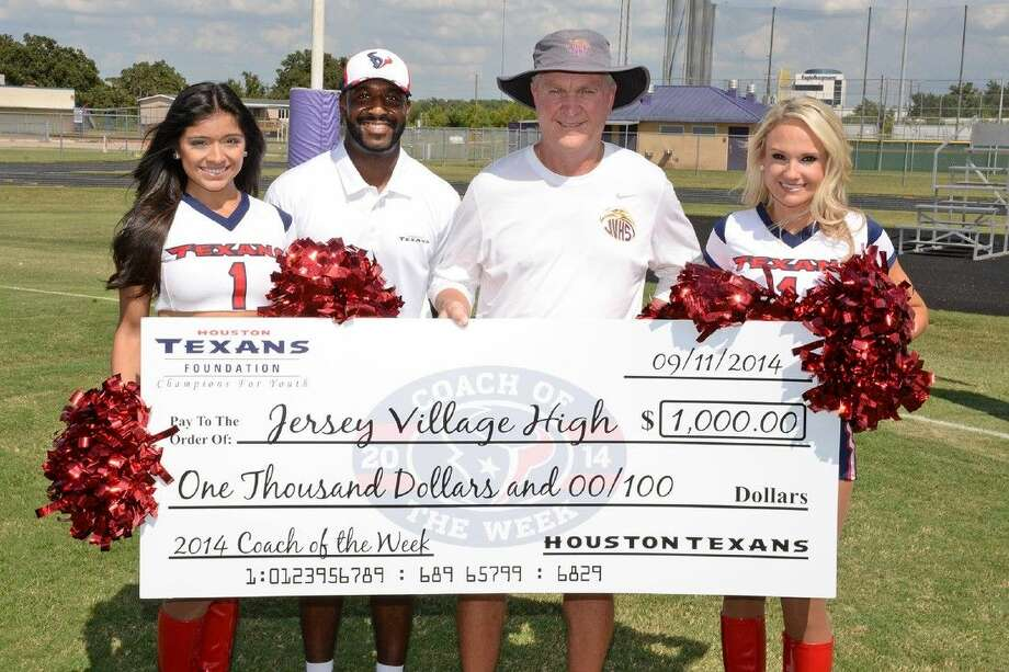 Submitted PhotoThe Houston Texans presented the Jersey Village athletic program with a $1,000 check after they named Jersey Village head football coach David Snokhous the Houston Texans High School Coach of the Week. Pictured, from left, are Texans cheerleader Osmara, marketing coordinator for events Brett Stewart, Coach Snokhous and Texans cheerleader Kim. Photo: Submitted Photo