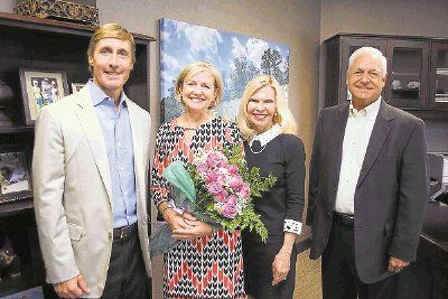 Linda Nelson (second from the left) has been named a 2015 Hometown Hero. Pictured with Nelson are Senior Vice President and CEO of Memorial Hermann The Woodlands Hospital Josh Urban, President and CEO of Interfaith of The Woodlands Dr. Ann Snyder, and former CEO of Memorial Hermann The Woodlands Steve Sanders.
