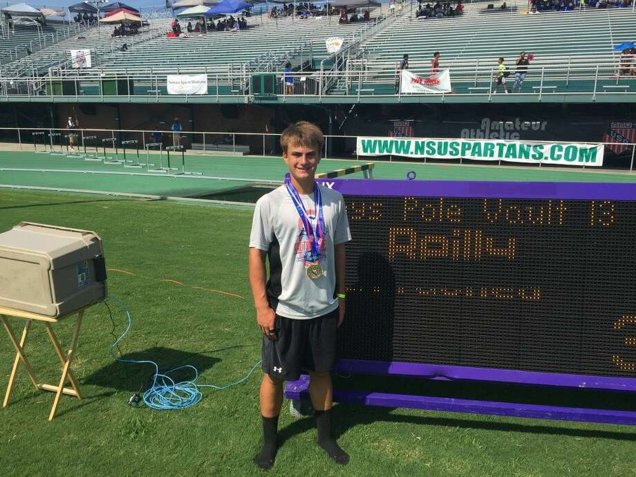 Jackson Reilly, 13, at the AAU Junior Olympics in Virginia Beach, Virginia. Reilly won the gold medal for boys' pole vault in the 13-year-old category, setting a record with a jump of 11-feet-8-inches.